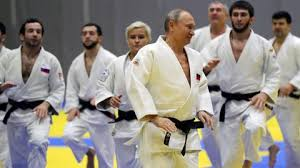 Putin demonstrates black belt judo skills