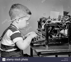 1940s BOY TYPING ON MANUAL TYPEWRITER PENCIL BEHIND HIS EAR - j997 HAR001  HARS WRITER JUVENILES NEWSMAN BLACK AND WHITE CAUCASIAN ETHNICITY HAR001  OLD FASHIONED TYPIST Stock Photo - Alamy