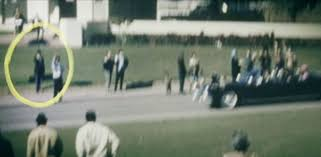"Why Conspiracy Theorists Are So Obsessed With JFK's ""Umbrella Man"" 